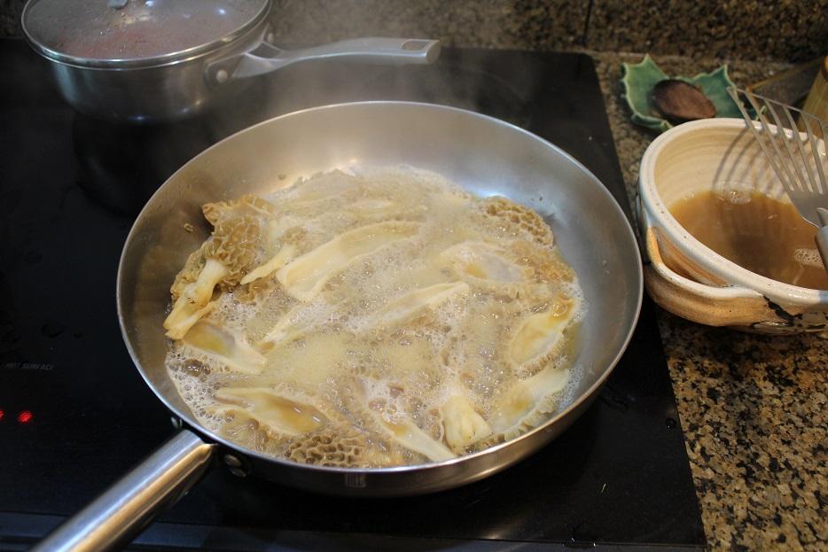 steam cooking morels in skillet